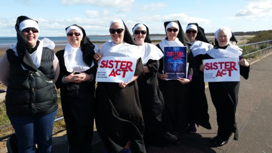 It's a blessing - The cast of Sister Act set out from Seton Sands for their walk to the Brunton. Photo: Encore