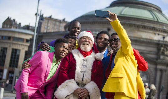 The Moes and Nomax get a selfie with Father Christmas. Photo: Duncan McGlynn