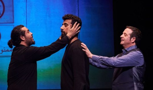 Alaa Shehada, Faisal Abualheja and Mark Thomas on stage in Show Time from the Front Line. Pic Steve Ullathorne