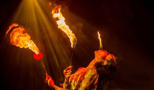 Heather Holliday breaths fire in La Clique Noel. Pic: Ian Georgeson