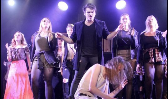 A scene from Jesus Christ Superstar with Kadee Fraser (left), Colum Findlay (centre standing) and Oliver Payn (foreground). Pic Captivate