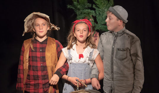 Lily Meyers as Scarecrow, Robin Hill as Dorothy and Hugh Harris as Tin Man in Tribe Porty Youth Theatre's EdFringe 2018 production of The Wizard of Oz.