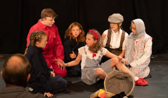 Robin Hill as Dorothy with members of the cast in Tribe Porty Youth Theatre's EdFringe 2018 production of The Wizard of Oz.