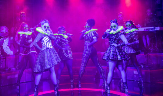 Kat Bax on Bass, Jodie Steele as Katherine Howard, Lauren Byrne as Jane Seymour, Shekinah McFarlane as Anna of Cleves, Athena Collins as Catherine Parr, Maddison Bulleyment as Anne Boleyn, Frankie South on 		Guitar, Lauren Drew as Catherine of Aragon, Arlene McNaught as Musical Director/Keyboard