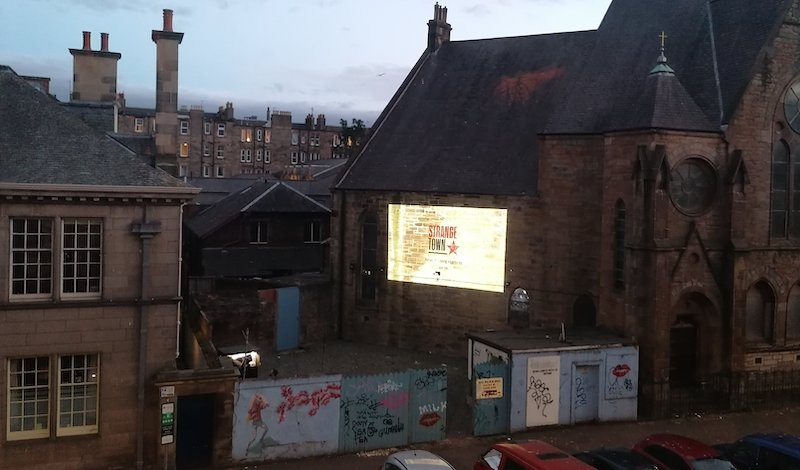The filmed section was screened against the side of the church next door to Out Of The Blue